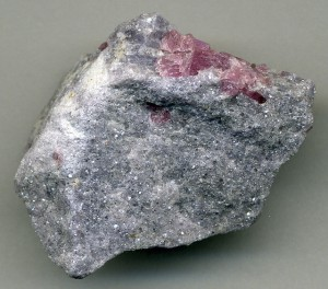 Lithia pegmatite with rubellite tourmaline in lepidolite mica matrix, Stewart Mine, southern California CC BY 2.0 James St John (on flickr)