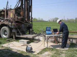 Contractor operating geophysical equipment at a drill site (GTS)