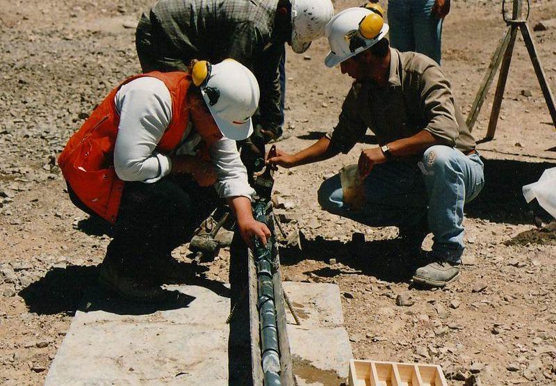 Exploration geologists examining diamond drill core