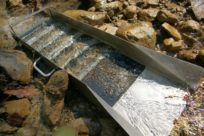 Sluice box for gold mining. Image: CC