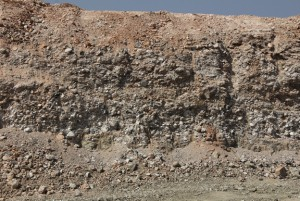 Typical exposure of  terrace gravels. Note the red, deflated surface at the very top - Photo from Rockwell Diamonds
