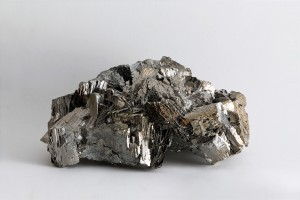 Steel-grey colored Arsenopyrite (FeAsS) is an iron-arsenic sulfide that can host gold within its crystal matrix.