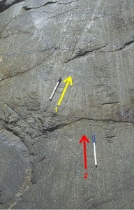 Two sets of striations show the direction of ice flow over this rock outcrop. The one on the left (yellow) truncates the one on the right.