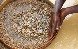 Women sieving for diamonds