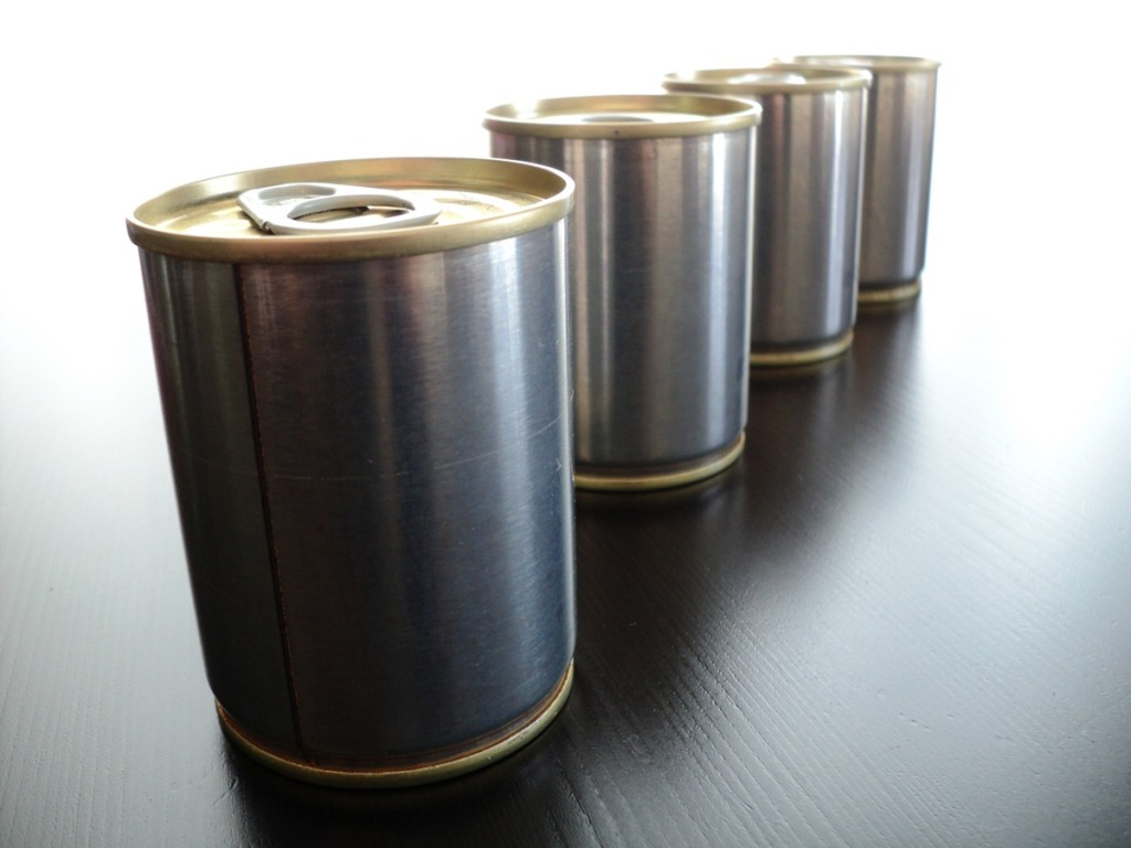 Tin cans are composed mainly of steel with a thin coating of tin.