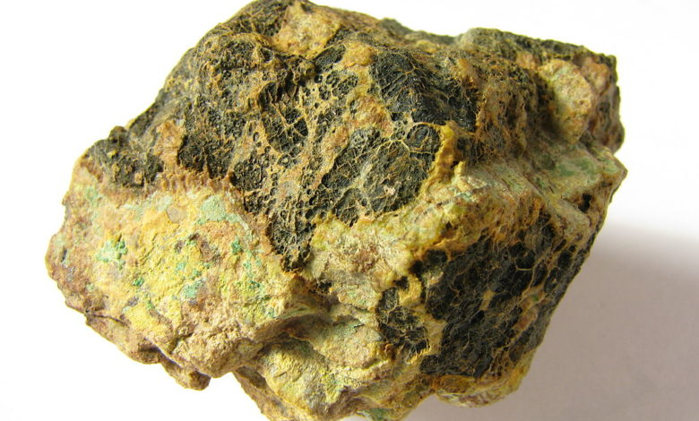 Pitchblende (black), or uraninite, is a major ore of uranium.
